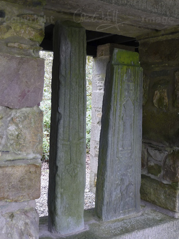 The shaft of the Kilberry Cross is on the right, showing the horseman and the mitred figure